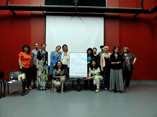 Limit_Less Participants pose with their finished poem